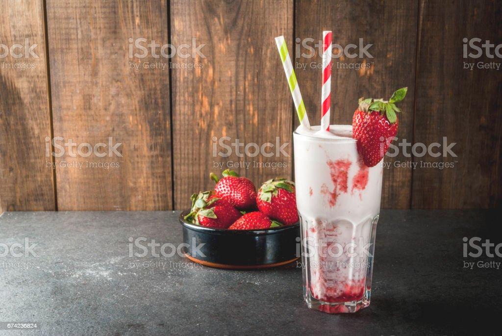 Milkshake with strawberries stock photo