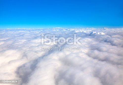 milky clouds , fluffy cloudscape and blue sky