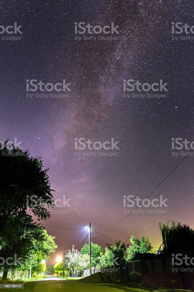 Milky way above a village street stock photo