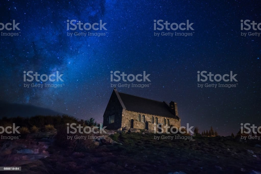 Milky way above Church of the Good Shepherd at Lake Tekapo New Zealand South Island. stock photo