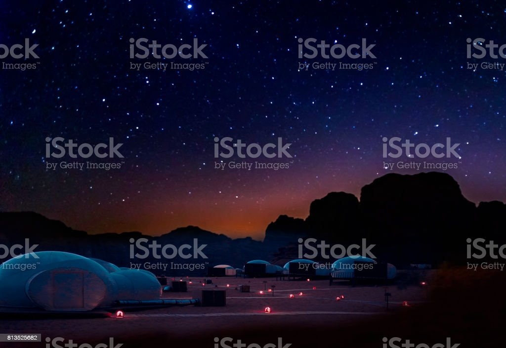 Milky Way and a lot of stars over the mountain at Wadi Rum desert.  Sky at night with wonderful landscape in summer, concept for space background and traveling. stock photo