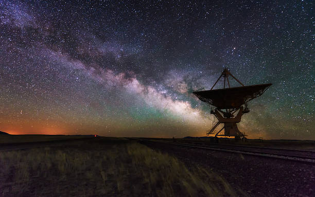 milky way and big antenna dish, telescope - space exploration stock photos and pictures