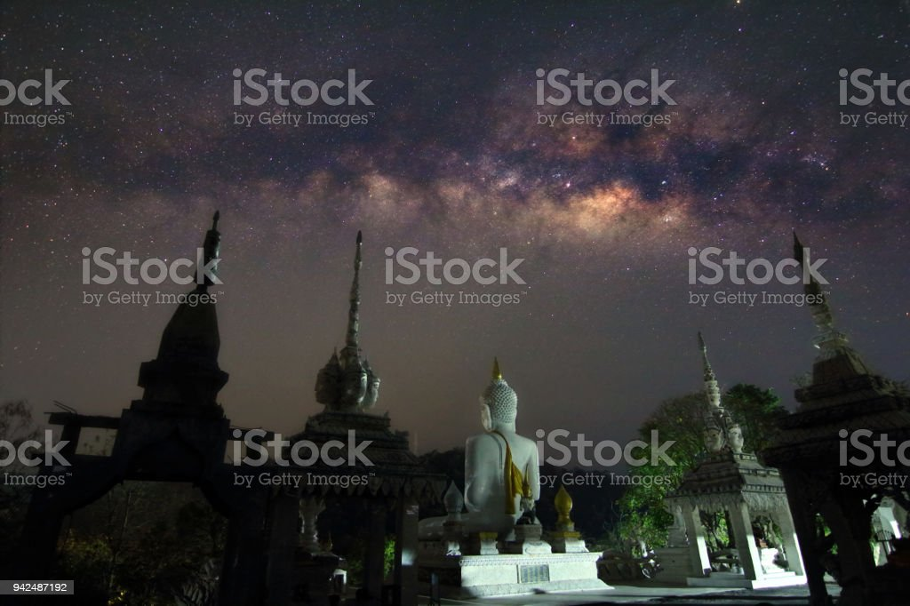 Milky way and many stars on night sky at Temple in Thailand stock photo