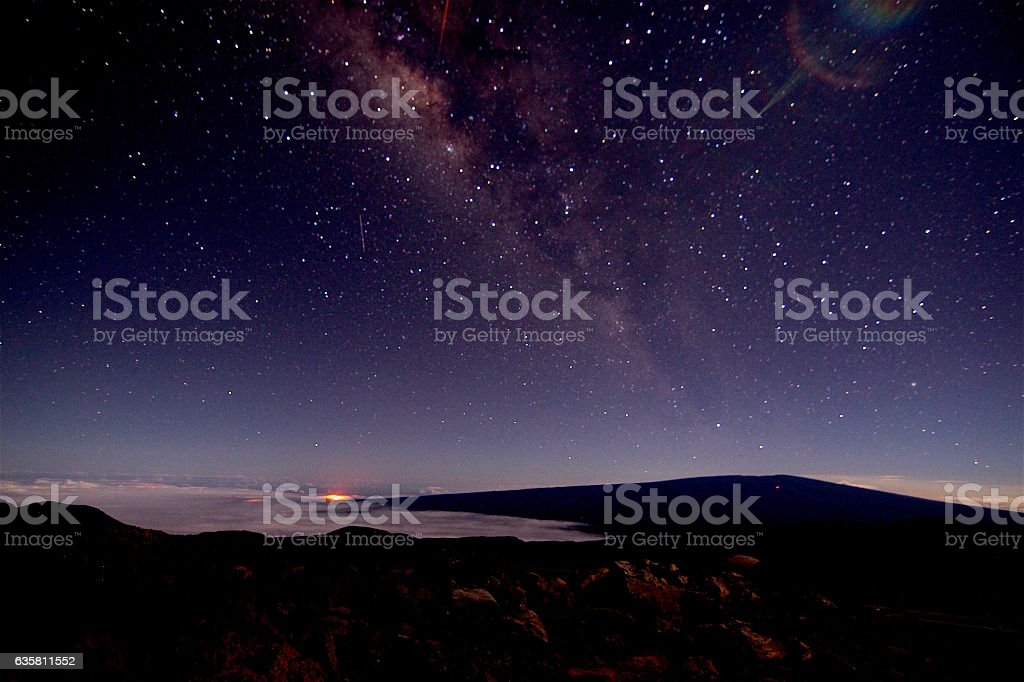 Milky Way and Volcano glow in the Distance stock photo