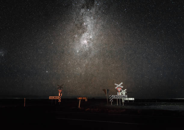 Milky Way Astrophotography night sky view in Australian Outback at railway crossing stock photo