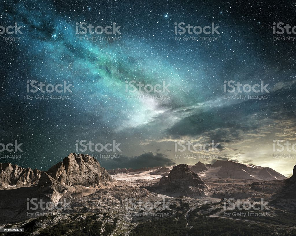milky way at dawn in a mountain landscape stock photo
