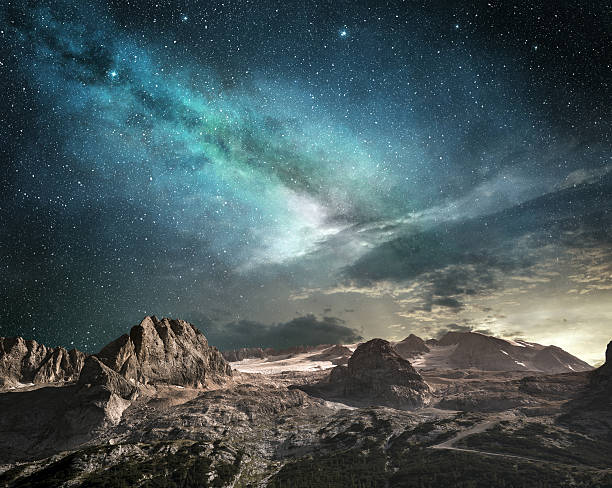 milky way at dawn in a mountain landscape - fantasy stock photos and pictures