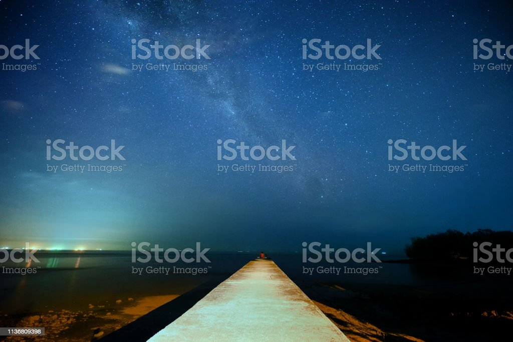 Milky Way at the pier of Port Dickson stock photo