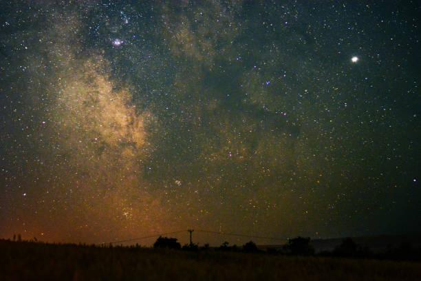 Milky Way Core Over Farm Land stock photo