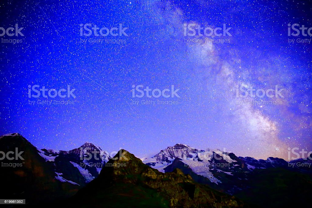 Milky Way galaxy above Jungfrau, Monch and Eiger, Swiss Alps stock photo