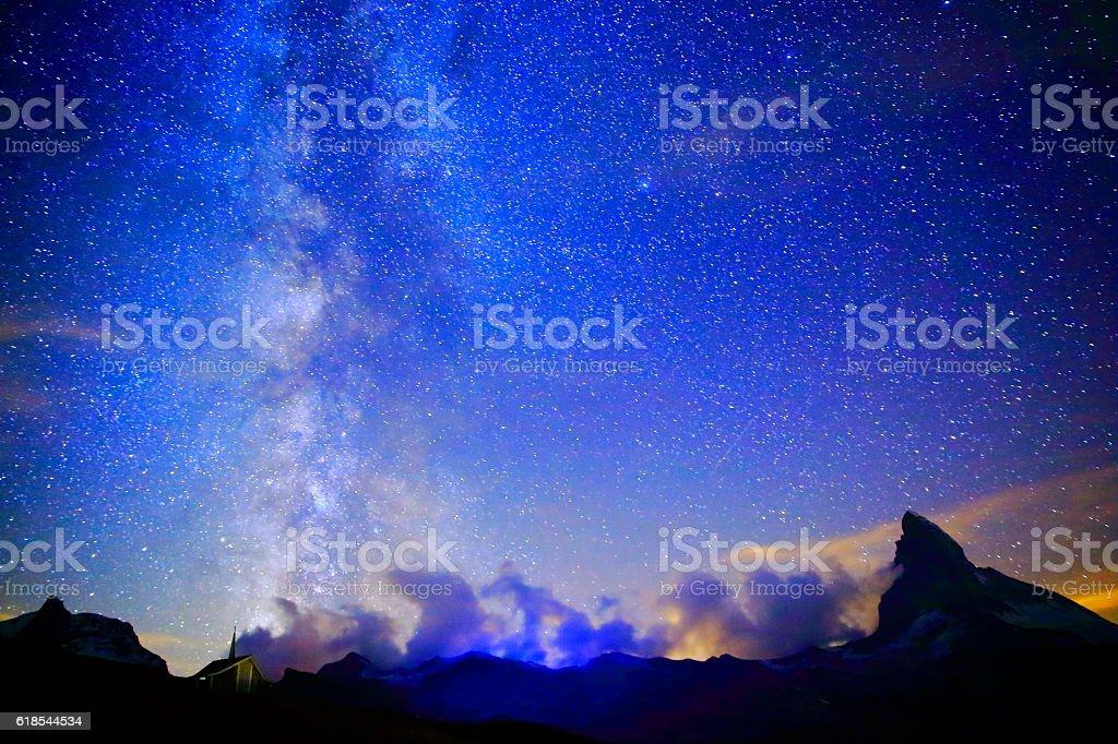 Milky Way galaxy above Matterhorn, Swiss Alps landscape at night stock photo