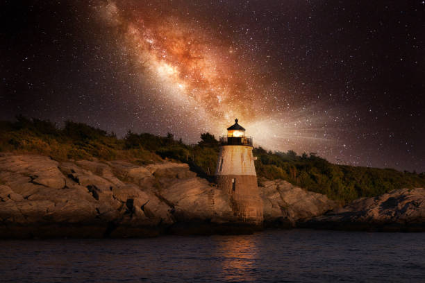 Milky Way Galaxy over Castle Hill Lighthouse in Rhode Island stock photo
