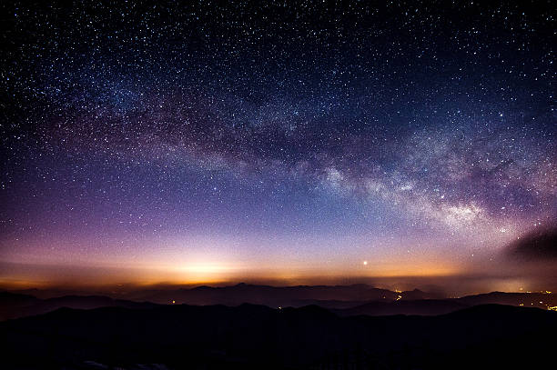 milky way galaxy over mountain at night, deogyusan mountain. - star shape stock photos and pictures