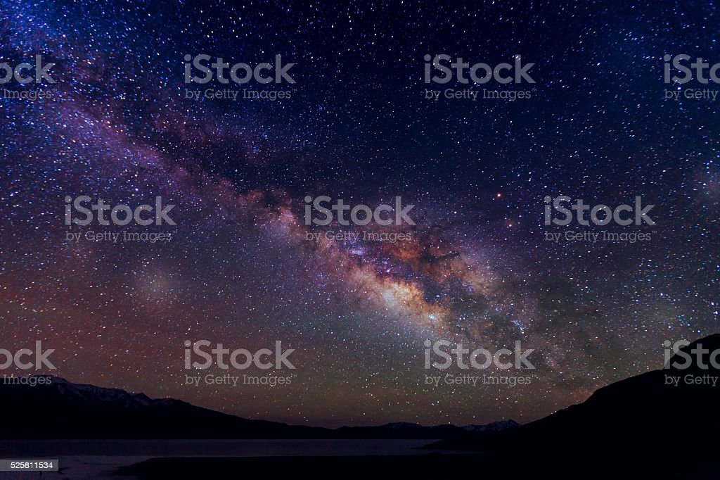 Milky way galaxy over mountain stock photo