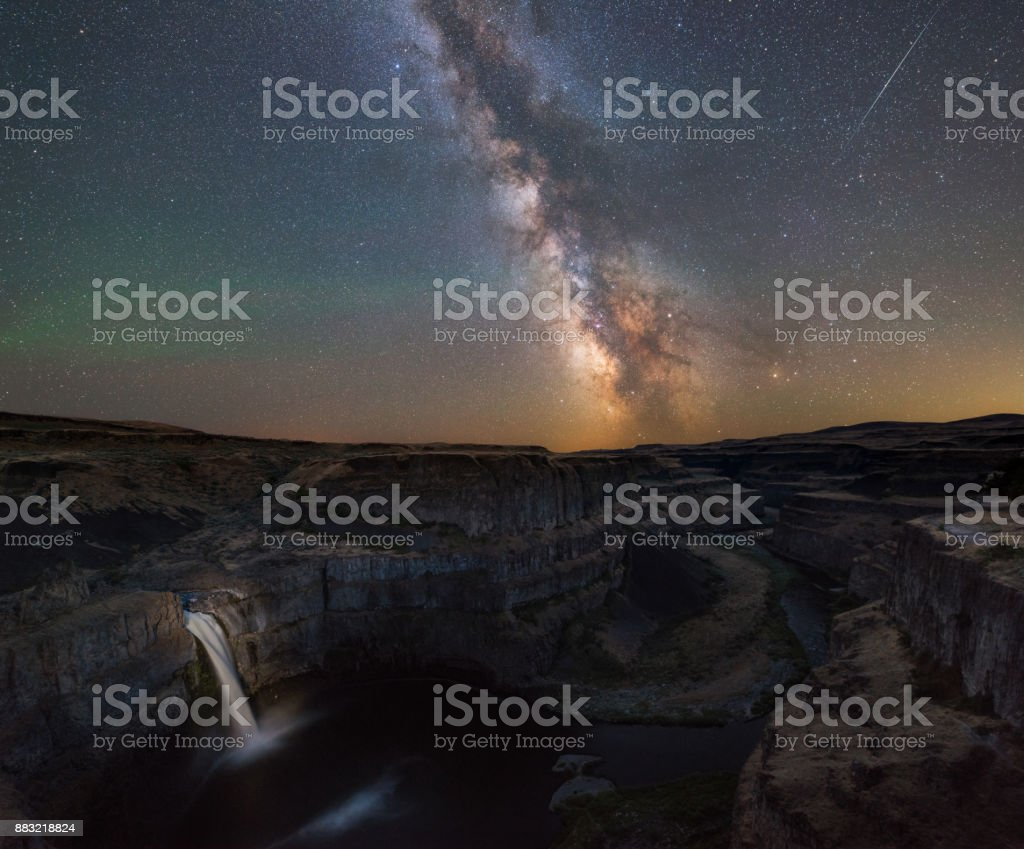 Milky Way Galaxy over Palouse Falls in Washington State stock photo