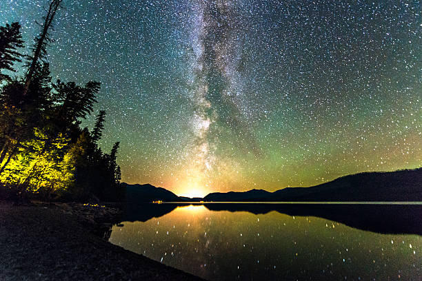 milky way galaxy stars in sky over scenic lake montana - mcdonald lake stock pictures, royalty-free photos & images