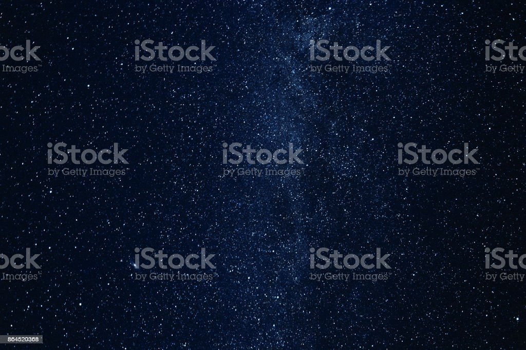 Milky way galaxy with glowing stars and planets in the universe. Dark blue sky in the night stock photo