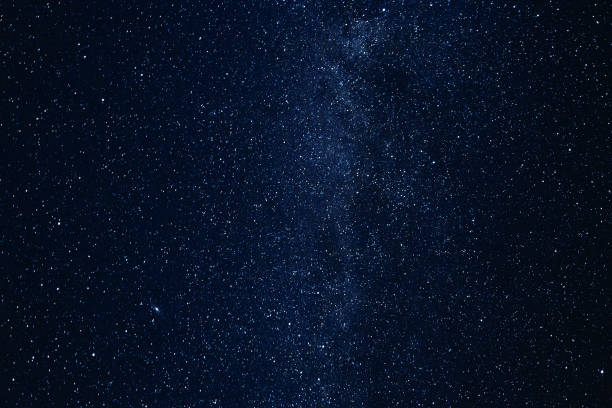 milky way galaxy with glowing stars and planets in the universe. dark blue sky in the night - stars imagens e fotografias de stock