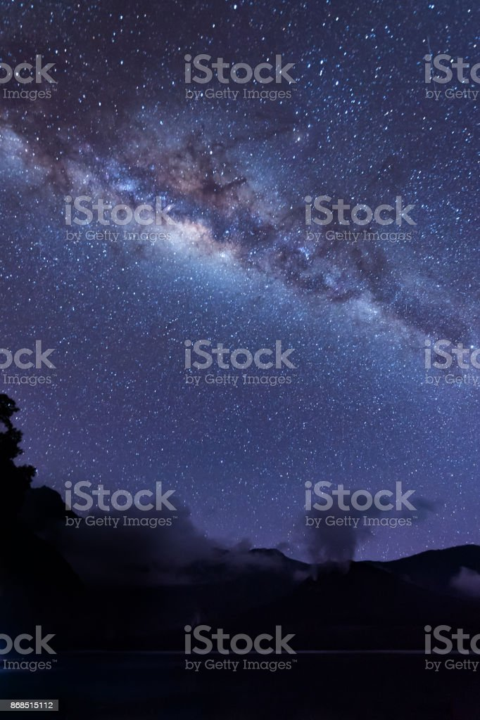 Milky Way landscape. Clearly Milky way above Lake Segara Anak inside crater of Rinjani mountain on night sky. Lombok island, Indonesia. stock photo
