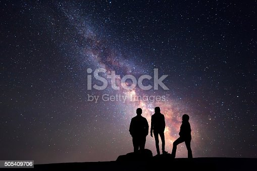 istock Milky Way. Night sky and silhouette of a family 505409706