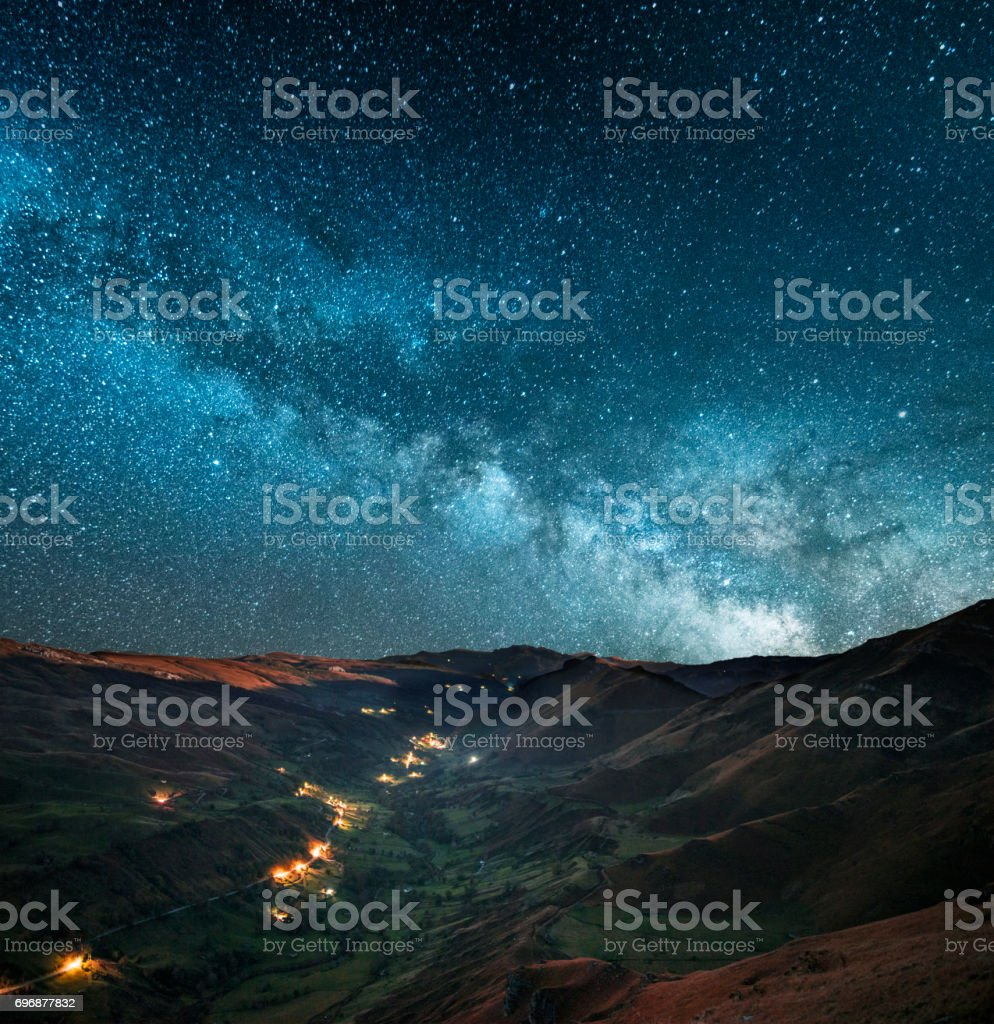 Milky way over green valley stock photo