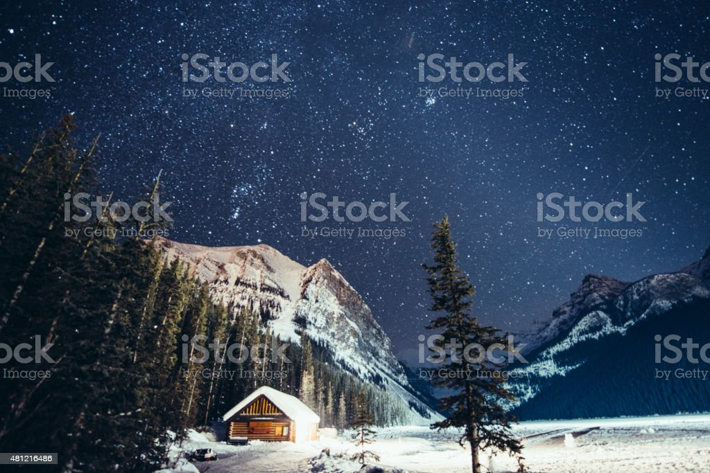 Milky way over Lake Louise in Banff National Park Winter stock photo