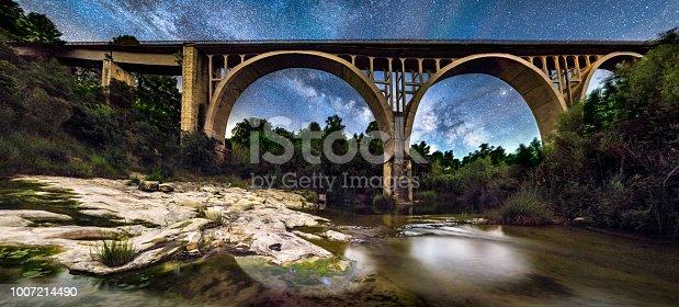 653506436istockphoto milky way over river algars in lledo and via verde bridge 1007214490