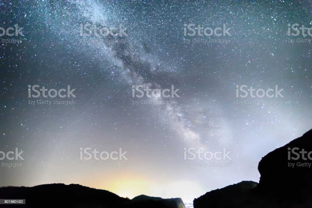 Milky Way over the Meteora, Greece. stock photo