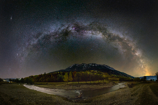 Milky way over the Piatra Craiului mountains and river from Romania