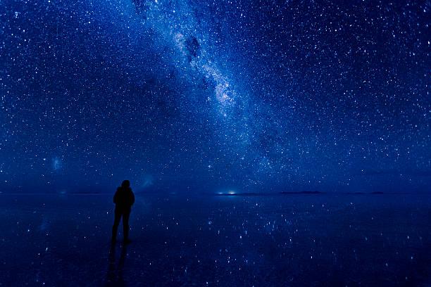 Milky way reflected on the water at Uyuni. stock photo