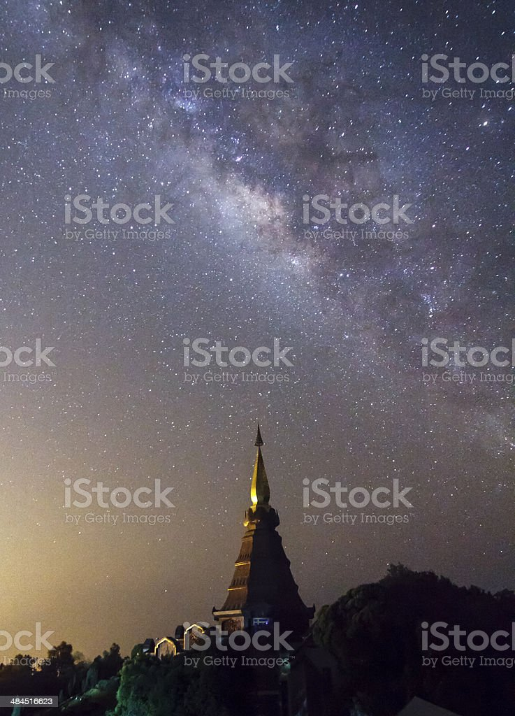Milky way rises over the pagoda , Thailand stock photo