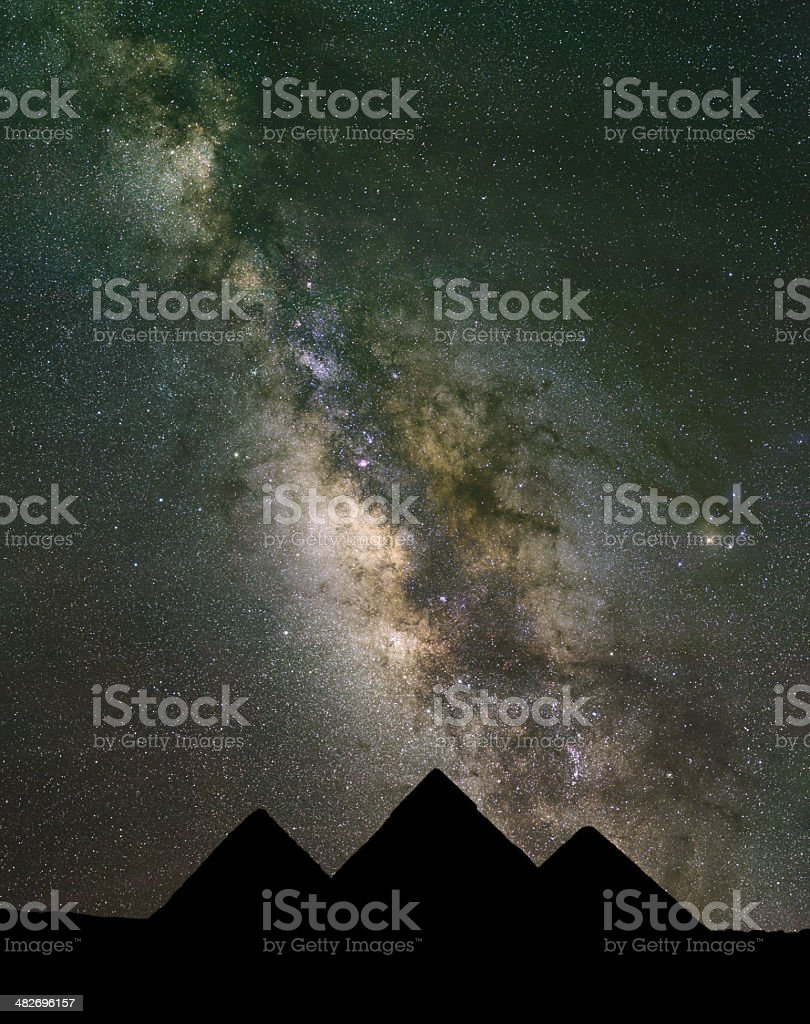 Milky Way rises over the Pyramids in Egypt. stock photo