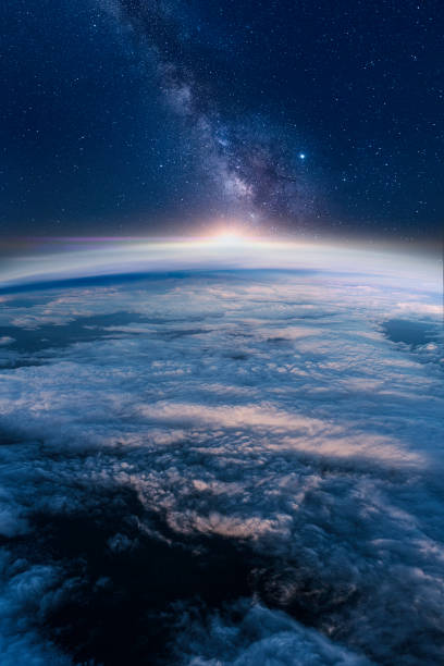 Milky way rising over the Earth's horizon View of stars and milky-way above Earth from space planet space stock pictures, royalty-free photos & images