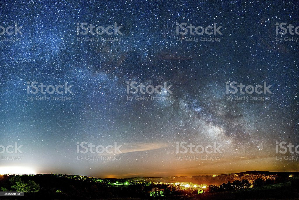 Milky Way rising over the Ozark Mountains stock photo