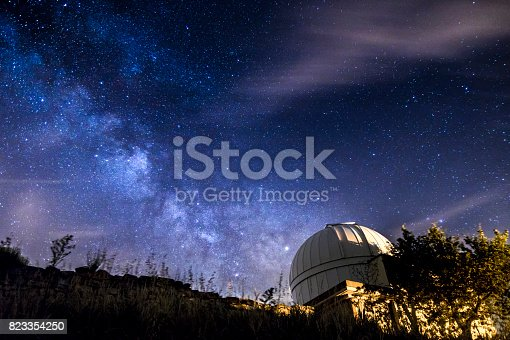 milkyway in the night over a telescope observartory
