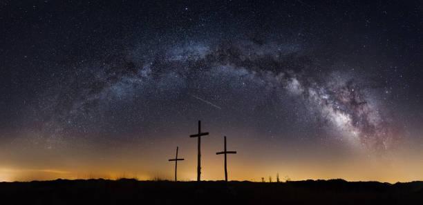 Milkyway galaxy over three crosses stock photo