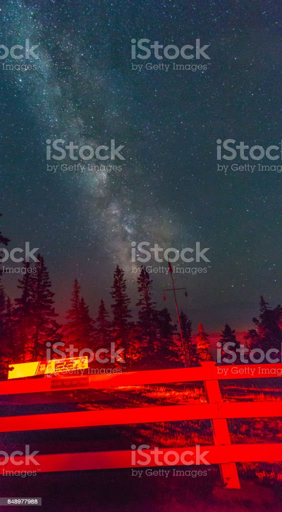 Milkyway over a fence at Acadia National Park stock photo