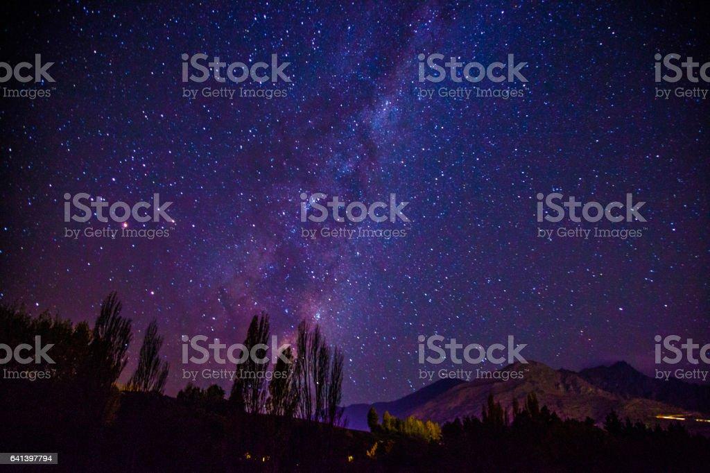 Milkyway with pink Aurora glow stock photo