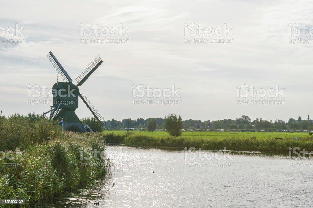 Mill along the river Alblas in Kinderdijk, The Netherlands stock photo