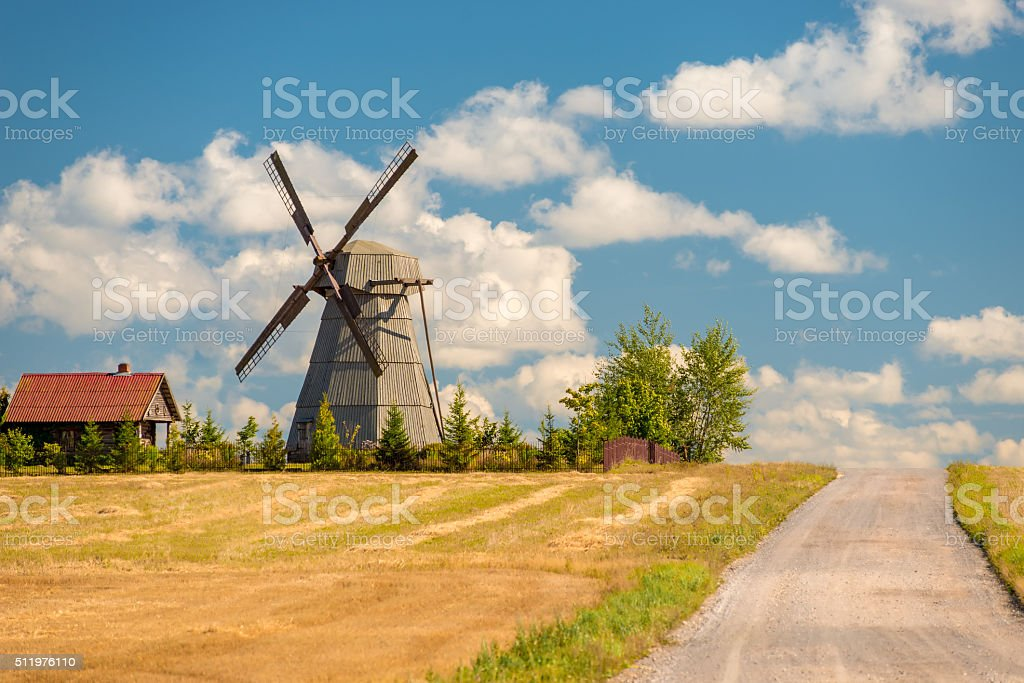 mill and rural house near country road stock photo