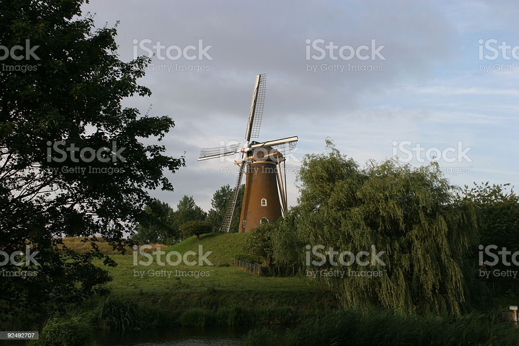 Mill on a terp in Holland royalty-free stock photo