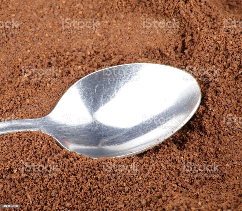 milled coffee and one teaspoon stock photo