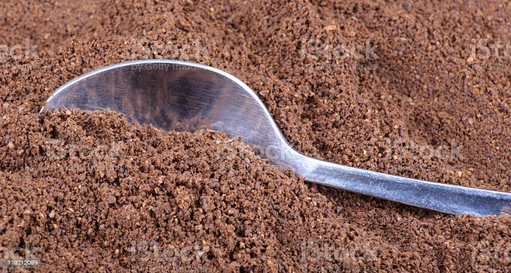 milled coffee  and teaspoon royalty-free stock photo