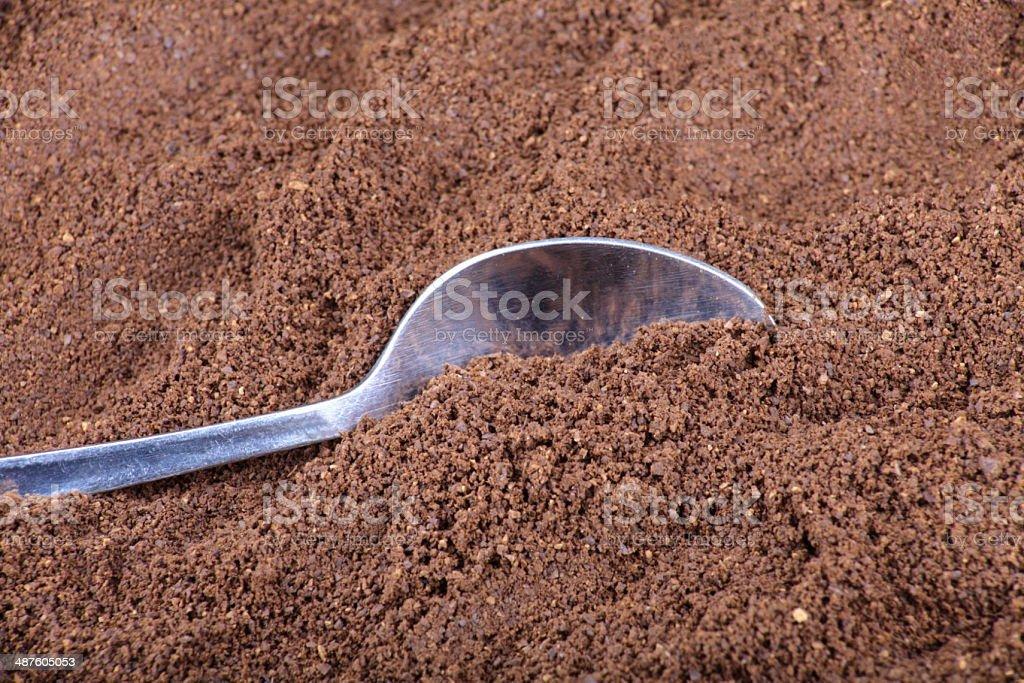 milled coffee  and teaspoon stock photo