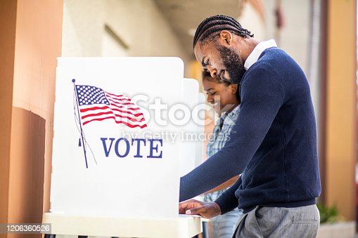 1001754954 istock photo Millenial Black Man and Woman Voting in Election 1206360526
