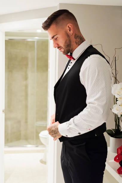 Millenial man getting ready for his wedding. stock photo