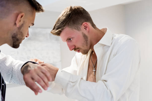Millenial men getting ready for wedding. stock photo