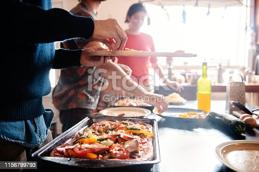 4 roommates live on this house and they are all vegetalian. They prepare a vegetarian pizza together. Photo was taken in Quebec Canada.