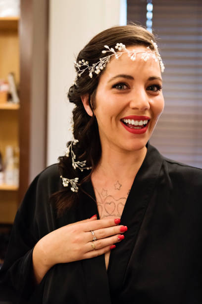 Millenial woman getting ready for her wedding. stock photo