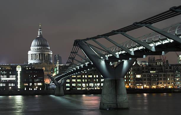 Millenium bridge and St. Paul catherdal in the night stock photo